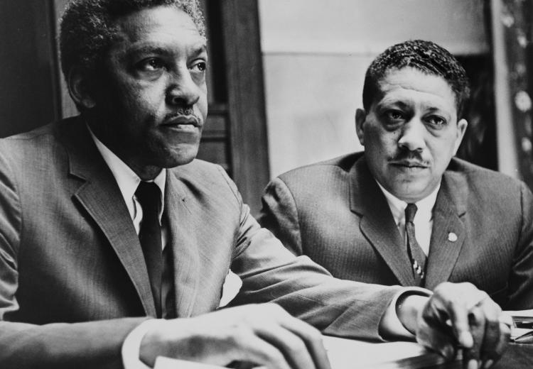 Bayard Rustin and Dr. Eugene Reed conduct are interviewed about the Vietnam War at Freedom House. Photo by Al Ravenna.